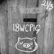Close-up of wine barrel end, chalk drawing of pigs face bottom-centre, above it is written 18WCPIG and top left is written 21/3